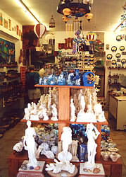 Gift shop 'Elaia' sells traditional pottery, jewelry, postcards, woven goods. books.